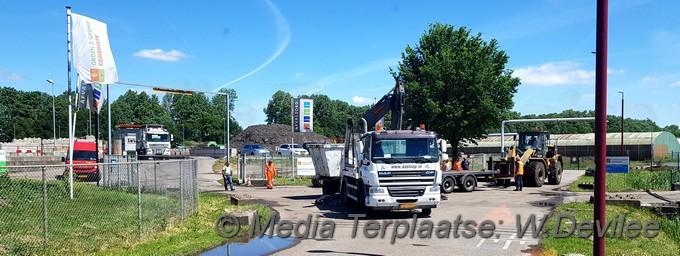 Containerwagen met hanger in de problemen